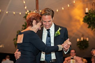 groom-in-a-navy-ralph-lauren-tuxedo-dances-with-mother-in-a-dark-dress