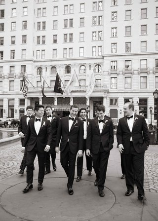 black-and-white-photo-of-groom-with-groomsmen-in-tuxedos-outside-courtyard-of-the-plaza-hotel-nyc