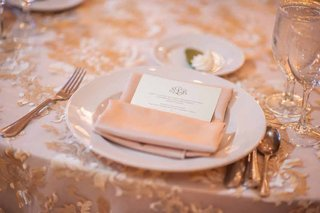 wedding-reception-table-with-gold-embroidered-overlay-satin-napkin-and-menu-with-couples-monogram