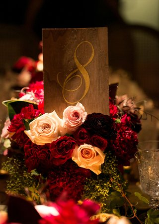 wood-table-number-on-top-of-roses-with-gold-calligraphy-number