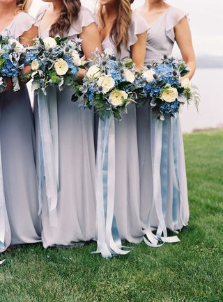 bridesmaids-in-short-sleeve-joanna-august-bridesmaid-dresses-with-blue-and-white-bouquet-ribbons