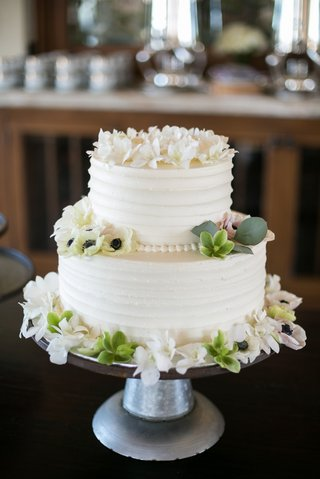 two-tier-wedding-cake-with-buttercream-frosting-and-floral-details