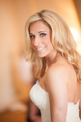 bride-in-a-strapless-lace-isabelle-armstrong-dress-with-loose-curls-and-subtle-makeup