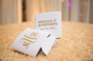 ivory-koozies-with-bride-and-grooms-names-monogram-wedding-date-in-gold-lettering