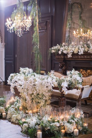 sweetheart-table-with-vintage-couch-table-with-cascading-orchids-piles-of-greenery-pillar-candles