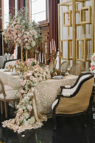 taupe-linen-intricate-details-champagne-chairs-cascading-floral-runner-pink-flowers-foliage-gold