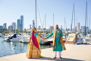 pakistani-couple-in-traditional-attire-hold-hands-on-dock-in-chicago
