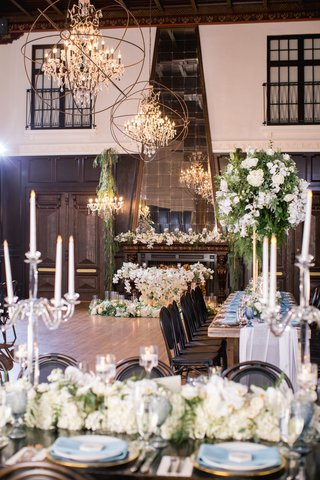 ebell-long-beach-wedding-with-candles-white-flowers-and-greenery-chandeliers-with-sphere-around