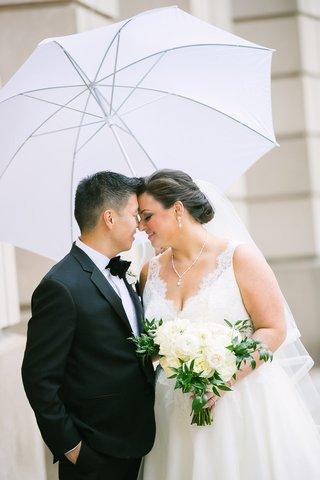 bride-and-groom-portrait-rainy-day-white-umbrella-tuxedo-lace-v-neck-dress