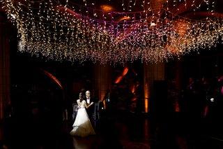 wedding-reception-father-daughter-dance-on-dance-floor-dark-with-twinkle-lights-overhead