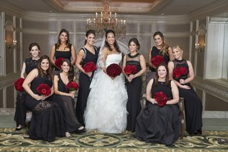 bride-in-vera-wang-wedding-dress-red-rose-bouquets-bridesmaids-in-mismatched-black-dresses