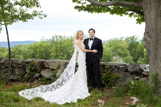 wedding-portrait-bride-and-groom-photo-bride-in-marchesa-wedding-dress-with-cape-groom-in-tuxedo