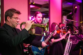 men-playing-trumpet-and-bass-guitar-at-reception