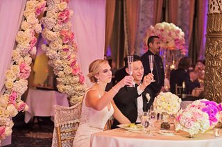 rob-refsnyder-of-new-york-yankees-and-wife-raise-glasses-for-champagne-toast