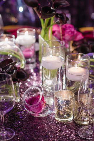 wedding-reception-table-with-candle-votives-mercury-glass-floating-candles-and-single-flowers-in-orb