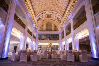 wedding-reception-in-renaissance-downtown-cincinnati-hotel-blue-uplighting-gold-details