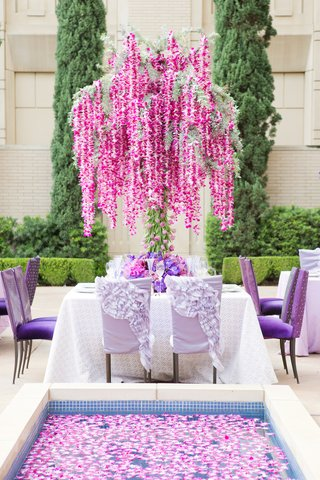 garden-wedding-reception-with-floral-tree-of-orchid-garlands-and-tulip-trunk-reflecting-pool