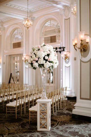 wedding-ceremony-tall-centerpiece-on-riser-pink-rose-white-rose-hydrangea-gold-sconces-gold-chairs