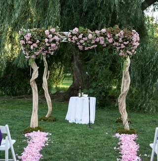 wedding-chuppah-with-woven-wood-and-pink-flowers