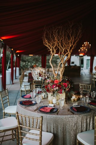 rose-gold-sequin-linen-navy-charger-plate-burgundy-napkins-manzanita-tree-from-floral-centerpiece
