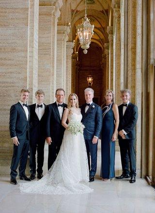 bride-in-romona-keveza-wedding-dress-groom-in-navy-tuxedo-custom-family-in-navy-and-black