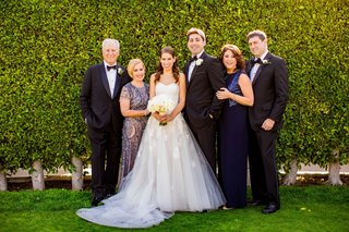 wedding-portrait-bride-and-groom-with-parents-mothers-in-sequin-navy-blue-dresses