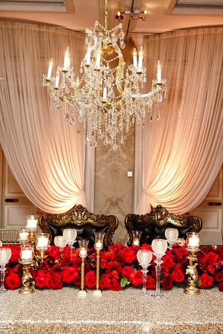 regal-sweetheart-table-red-rose-runner-candlesticks-black-cushioned-chair-with-ornate-gold-border