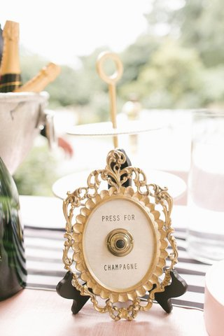 framed-button-to-press-for-champagne-at-wedding-bar