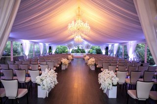 four-seasons-hotel-los-angeles-at-beverly-hills-ceremony-drapery-chandelier-tent-purple-lighting