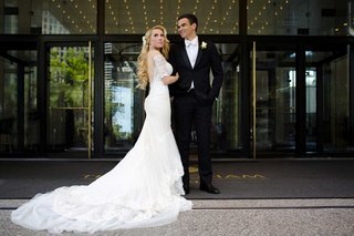 bride-in-galia-lahav-wedding-dress-low-back-half-sleeves-long-blonde-hair-groom-in-tuxedo-white-tie