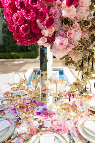 pink-rose-centerpiece-mirror-stand-floral-table-linen-gold-topped-glasses-white-china