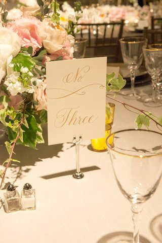 white-and-gold-calligraphy-number-number-on-white-table-linens