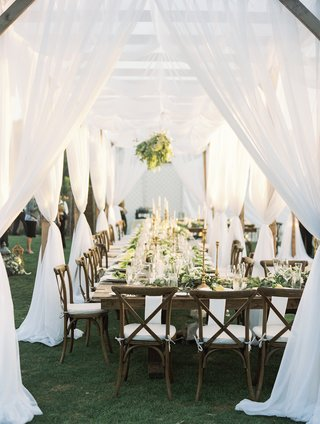 outdoor-wedding-reception-vineyard-chairs-white-and-greenery-white-canopy