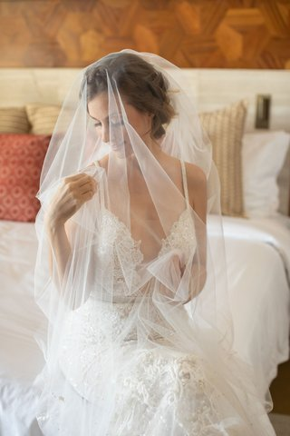 wedding-portrait-bride-getting-ready-on-bed-berta-wedding-dress-bridal-veil-over-face-tulle