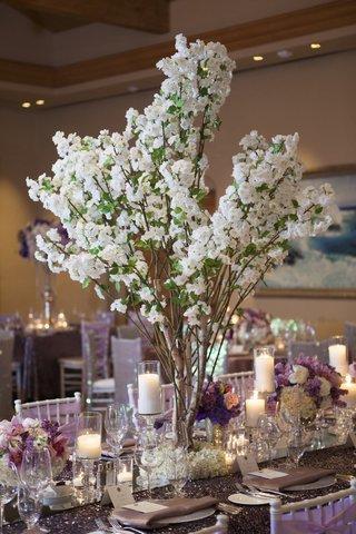 purple-sequin-wedding-decorations-with-branch-centerpiece