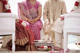 bride-and-groom-sitting-on-white-furniture