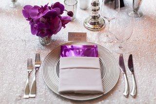 metallic-purple-menu-card-in-silver-napkin-on-white-sequin-table