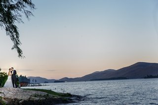 bride-and-groom-at-shore-of-lake-george-sunset-wedding-photos-on-the-lake