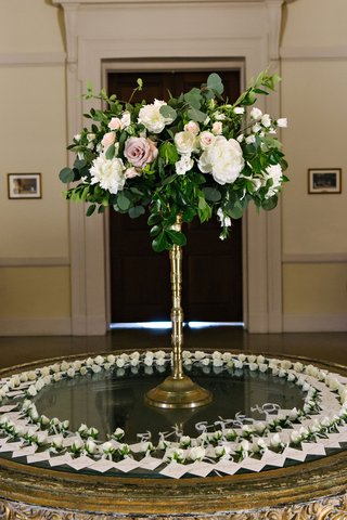 wedding-reception-tall-gold-flower-holder-rose-greenery-flowers-attached-to-escort-cards