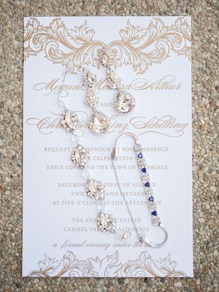 brides-dangling-earrings-crystal-bracelet-and-bracelet-with-blue-gemstones-on-white-gold-invitation