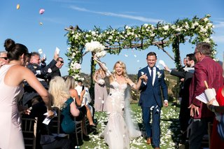 bride-in-pallas-couture-gown-with-blush-nude-lining-groom-in-navy-burberry-suit-recessional