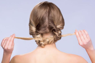 grab-each-braid-and-tie-in-a-knot-in-the-back-of-your-head-and-pull-tight