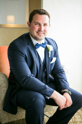 groom-in-navy-joseph-abboud-suit-blue-bow-tie-black-watch