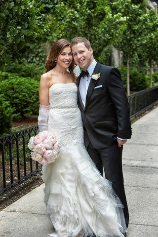 bride-strapless-vera-wang-wedding-dress-with-ruffle-skirt-groom-in-tuxedo-and-pink-peony-bouquet