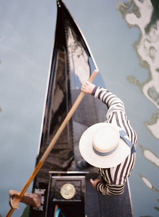 aerial-view-of-gondola-driver-gondolier-striped-shirt-and-hat
