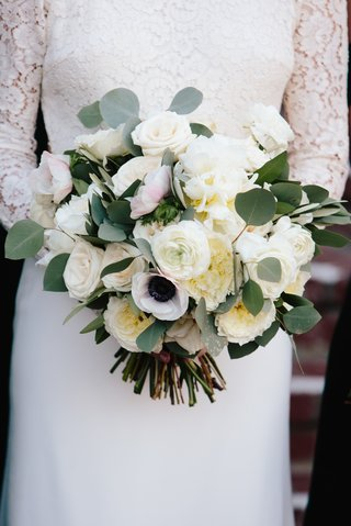 bridal-bouquet-with-ivory-roses-garden-roses-anemones-and-eucalyptus-leaves