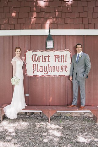 bride-and-groom-at-crist-mill-playhouse-with-white-lace-short-sleeve-wedding-dress