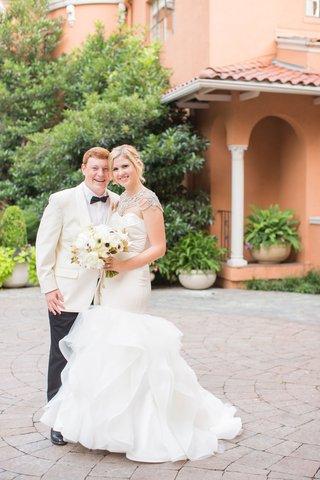 bride-in-hayley-paige-mermaid-gown-with-crystal-bolero-groom-in-white-tuxedo-jacket-bow-tie-dallas