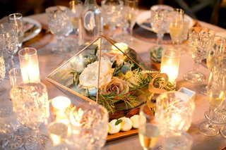 rose-gold-copper-geometric-terrarium-on-table-triangle-with-flowers-surrounded-by-candles-number