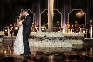 bride-in-oscar-de-la-renta-groom-in-j-hilburn-first-dance-live-band-ivory-floral-displays